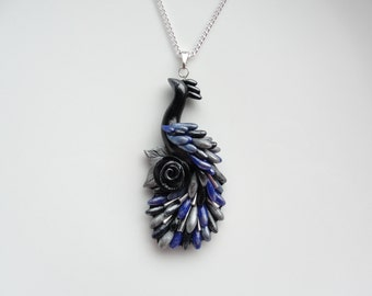 Peacock necklace handmade from polymer clay in black, silver and blue colours