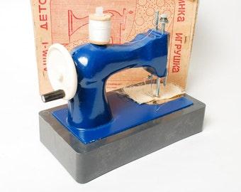 Girl Metal Toy, Sewing Machine, Blue, 1980s. in carton box.