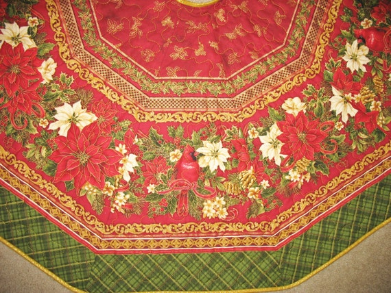 Christmas tree skirt with red cardinals and poinsettias from