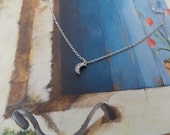 Sterling silver tiny  heart or half moon. Dainty necklace. Rhodium finish with CZ.
