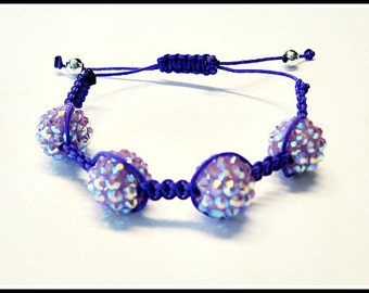 Purple Bead String Bracelet Featured in Glamoholic Magazine with Joey King