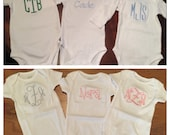 Set of three monogrammed onsies for a girl or boy