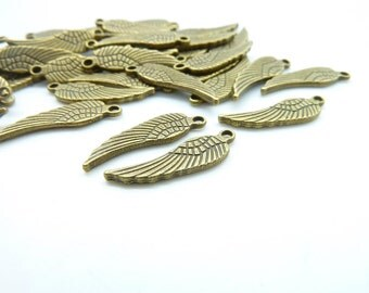 100pcs 5x16mm Antique Bronze  Mini Size DoubleSide Wing Charm Pendant c5086
