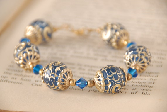 https://www.etsy.com/listing/209577809/exotic-blue-and-gold-bracelet-swarovski?ref=shop_home_active_9
