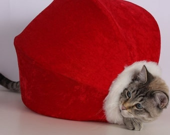 Adorable red velvet Christmas pet bed with white fur trim and striped lining - the Cat Ball kitty cave for your furbabies