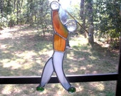 LT Stained glass Man Golfer sun catcher light catcher maroon, green and beige mix top gray streaked pants with golf club