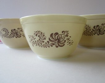 "Vintage ""3"" piece Pyrex nesting bowls with a ""Homestead"" design."