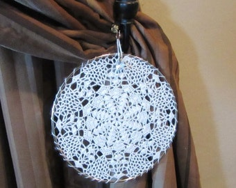 8 inch Delicate eye-catching crochet window or wall hanging with a small crystal