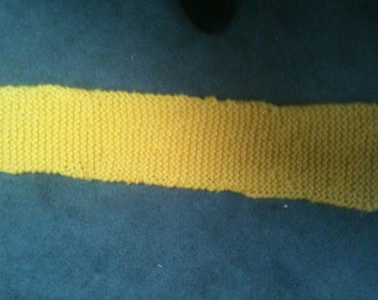 Knitted yellow wool scarf