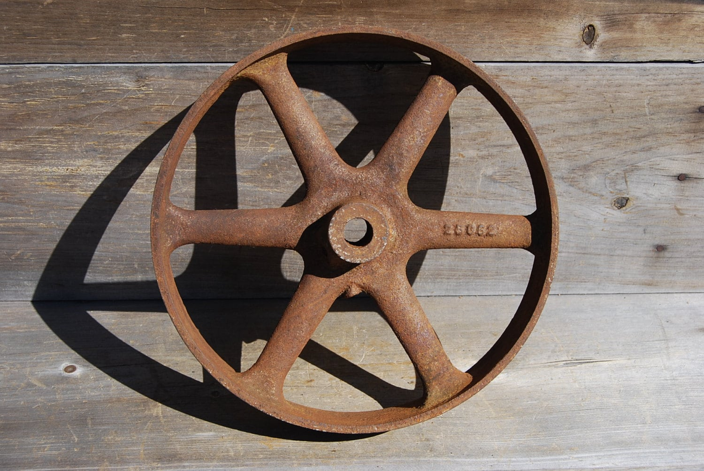 Vintage cast iron flat belt pulley by psychedelphia