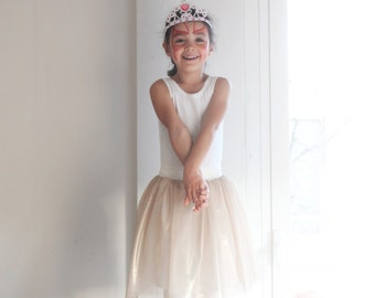 Girls' tutu glossy golden tulle skirt. Costume ballerina, dress up fairy. Carnival costume.