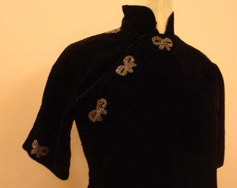 Black velvet cheongsam with rhinestone bows
