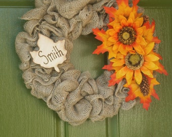Handmade Burlap fall wreath with engraved family last name. Perfect for a fall autumn decoration or thanksgiving gift