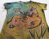 New design, dogs in big trouble, playing in the flower beds...woman's large discharge t-shirt with dyes orange, pink, blues, chartreuse