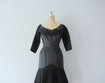 Vintage black cocktail dress . 1950s black silk dress