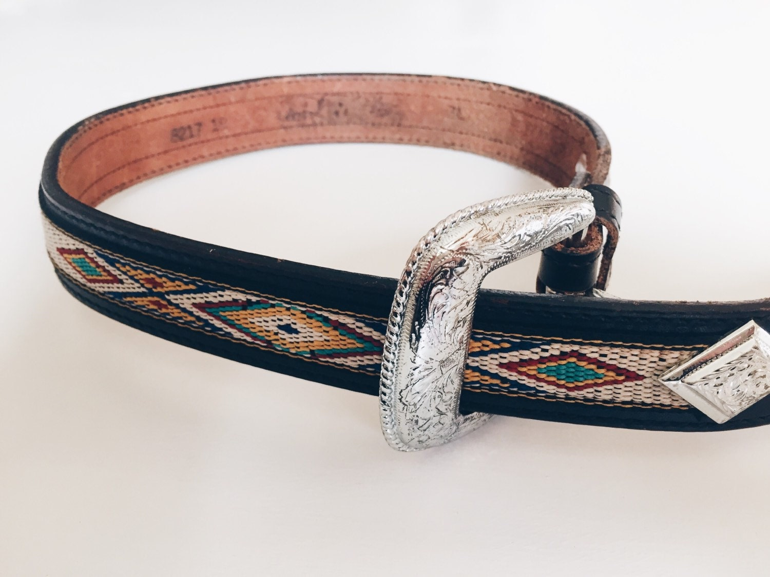 vintage black leather tribal belt with silver buckle
