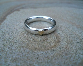 Simple sterling silver band ring with gold heart