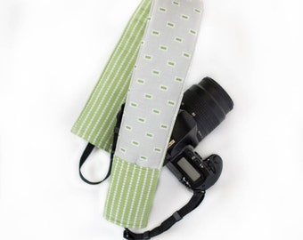 DSLR camera strap cover with lens cap pocket.  grey and green squares with stripe.