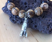Kids Buddha worry bead wood mala meditation bracelet with rocket ship charm and natural jasper gemstone