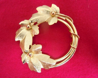 Gold Circle With Textured Leaves Brooch