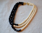 Faux Pearl and Black Bead Three Strand Necklace with Gold Details