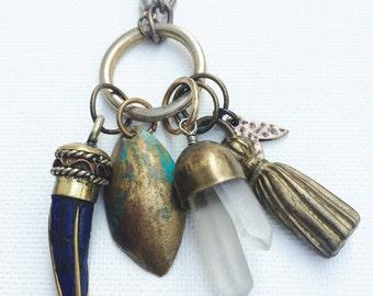 Cobalt Curiosities Necklace -- blue stone horn pendant, assorted metal charms, crystal quartz points & reclaimed chain necklace