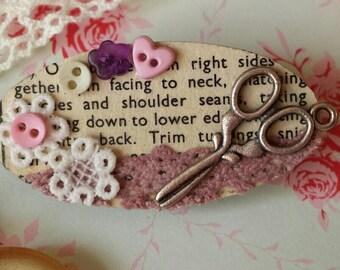 Vintage sewing pattern decoupaged brooch.