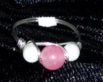Rose Quartz 6mm and white stone 4mm beads wire wrapped in 22 gauge sterling silver wire.