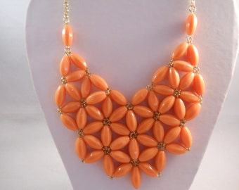 Bib Necklace with Gold Tone and Orange/Pink Flower Pendants on a Gold Tone Chain