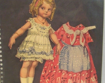 Vintage Ritzy paper doll by Rose O'Neill and Ragsy's costume 1932