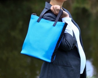 100 % handmade, handstitched  sky blue and brown  leather  bag, by GENATI.