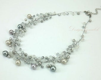 Grey freshwater pearl hand knotted on silk thread necklace.