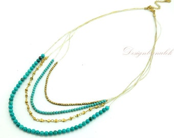 Blue crystal and silver beads on silk necklace.