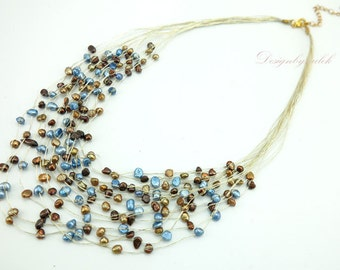Brown and blue freshwater pearl on silk necklace.