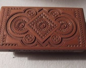 Vintage beautiful hand carved Bohemian box with hinged lid size 4 x 8 with round pegged legs a great vintage carved box