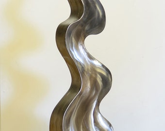 Abstract modern Flame of Life sculpture in stainless steel