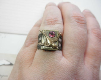 Adjustable Antiqued Brass Swallow with Purple Rhinestone Locket Ring
