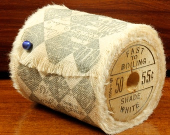 Harlequin  - Vintage Inspired Hand-Stamped Tea Dyed and Frayed Muslin Trim Around A Charming Wooden Spool