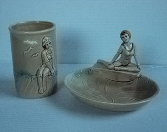 A vintage tan bathroom set glass and soap dish with pin up girls by Enesco