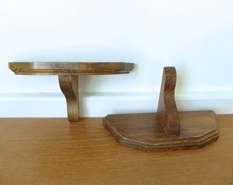Two small solid wood wall brackets