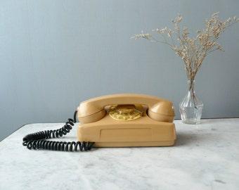 Vintage rotary phone. Cream rotary phone