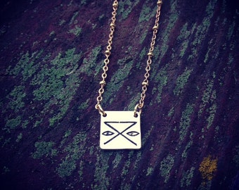 """Hobo symbol """"Safe Camp"""" Lost-wax brass pendant necklace."""