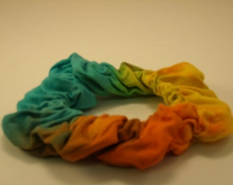 Blue with Orange and Yellow Tie Dye Hair Scrunchie. Hand Crafted by Blythe.. Made in the USA.