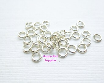Sterling Silver 4mm Hard Snap Jump Rings...  25 pieces... 20 gauge