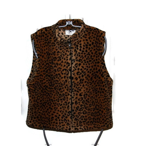 "Go on the prowl for compliments when you wear this sexy leopard print vest. Cut in a figure flattering, longer style, this vest will be your ""go to"" wardrobe piece."