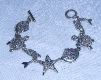 silver bracelet sealife characters dolphin turtle starfish seashell charms toggle bracelet