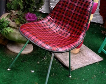 Original Herman Miller shell chair. Newly upholstered in plaid leather