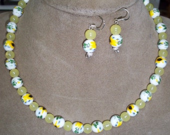 handcrafted beaded necklace with matching bracelet and earrings