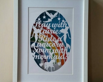Play with fairies, ride a unicorn, swim with mermaids floating framed paper cut