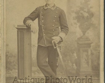 Italy soldier in uniform with sword antique cabinet photo